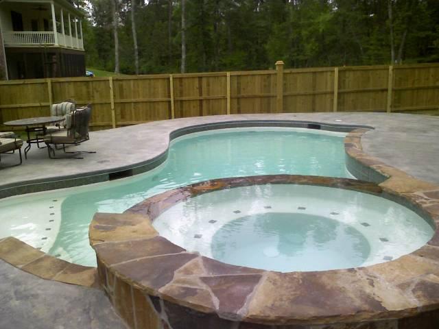 Custom swimming pool ideas arkansas pool contractors for Raised pool ideas
