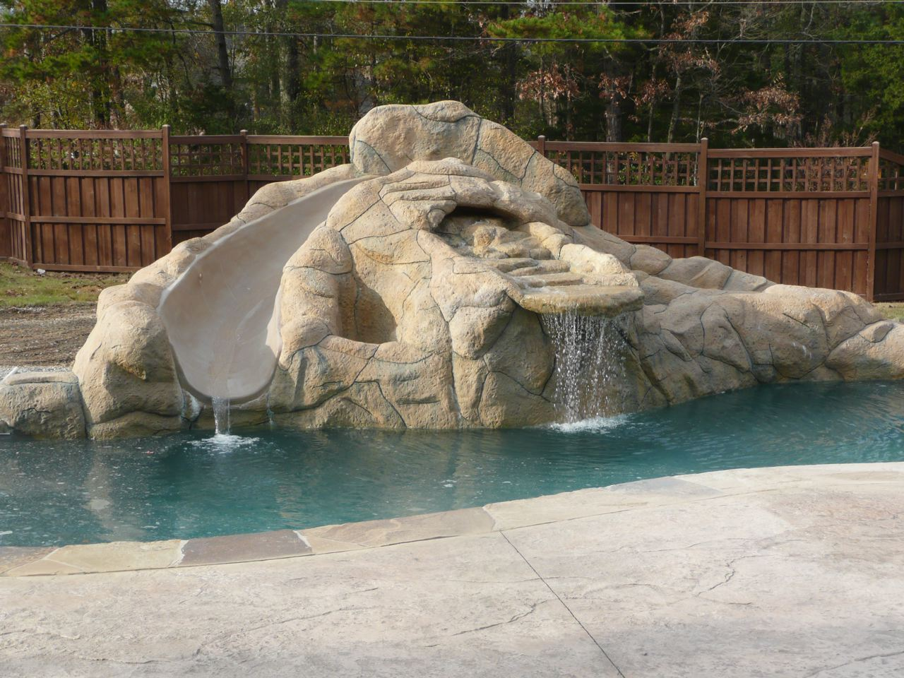 Custom swimming pool ideas arkansas pool contractors for How to build a swimming pool slide