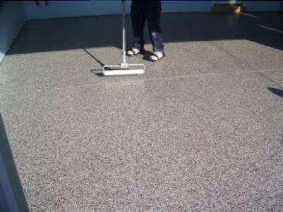 Professional installer applying the clear coat of polyurea