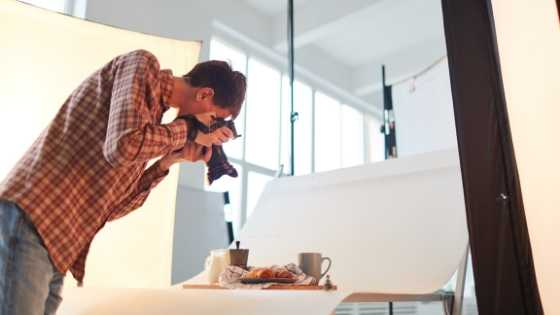 Man Taking Photos In A Studio