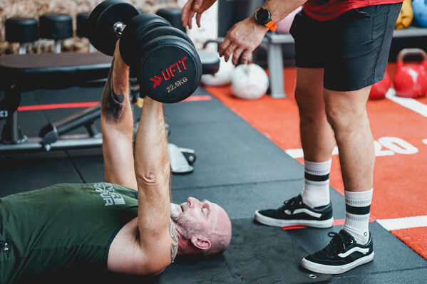 Dumbbell Floor Presses at UFIT Club Street Personal Training