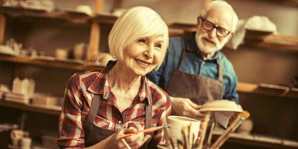 Community activities for seniors includes painting classes, which this image shows.