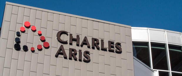 Charles Aris front of building