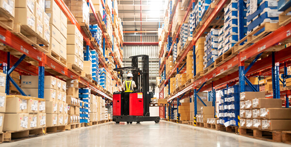 LED lights in industrial setting with person driving forklift
