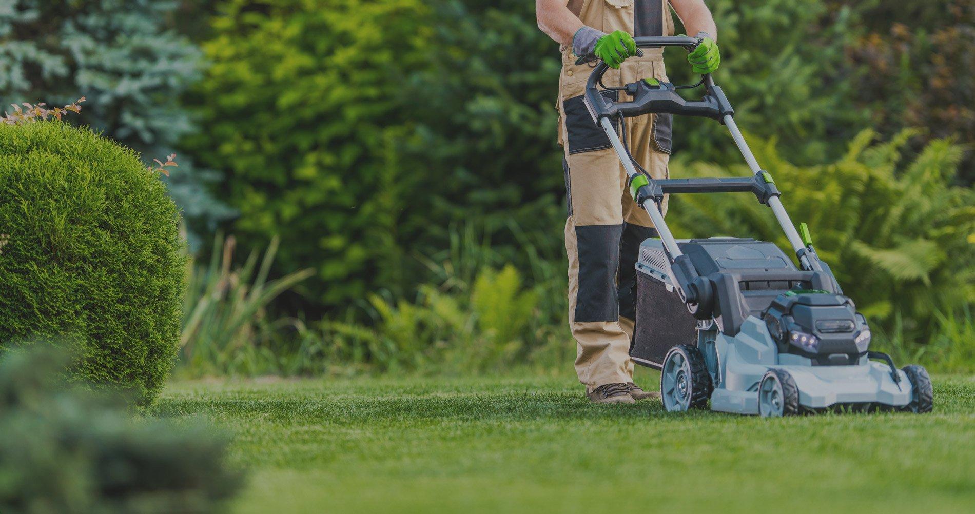 man-mowing-lawn-dark-gray-overlay