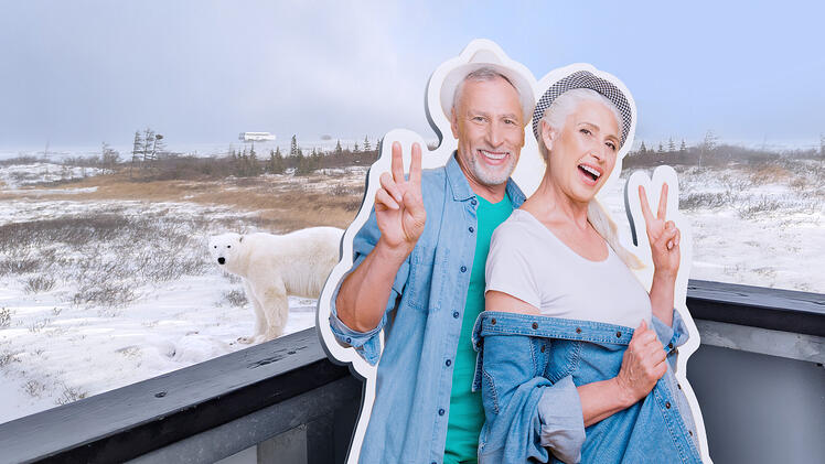 Two guests on the back of a Tundra Buggy viewing polar bears in Churchill, Manitoba!
