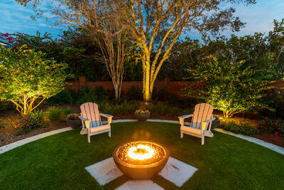 artificial turf fire pit seating chairs container planting tree lighting