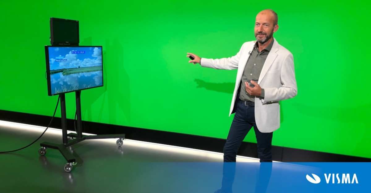 Weatherman Reinier van den Berg in front of a green screen in a television studio