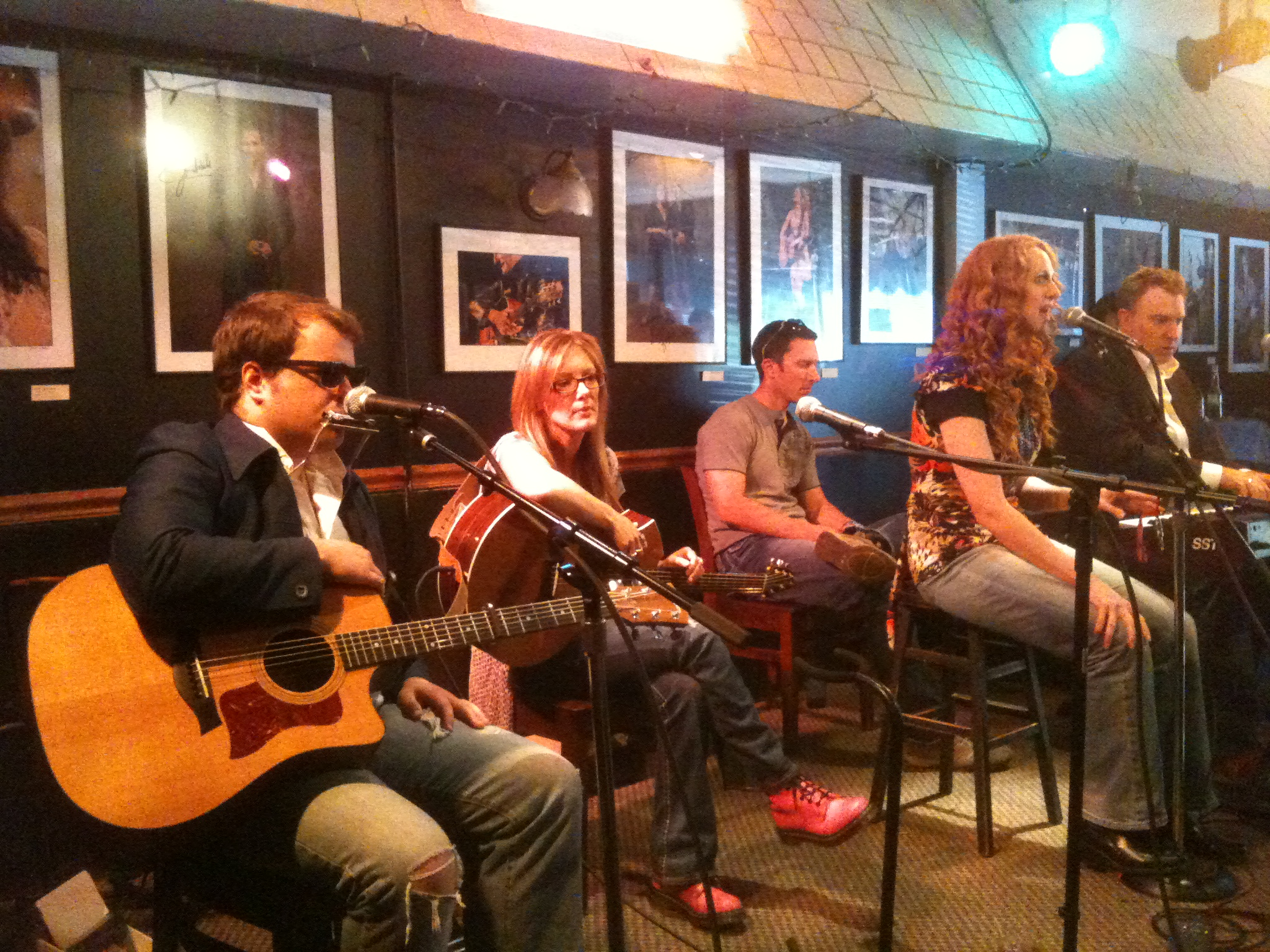 "Tom Schreck, Chaise Flanders, Nathan Brumley, Katie Miner ""Songwriters-In-A-Round"" format at USA Songwriting Competition's showcase at Bluebird Cafe showcase"