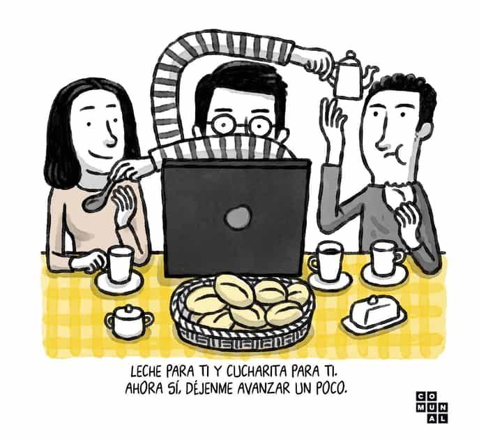 hombre sentado en mesa de comedor dando de comer a sus hijos y trabajando al mismo tiempo en su laptop