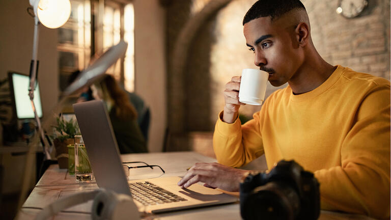 College student drinking coffee