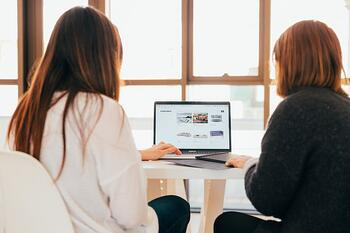 two people looking at a computer