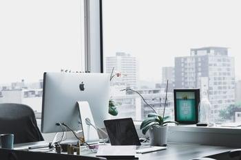 desktop monitor on desk in city office