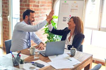 Business people giving each other a high five