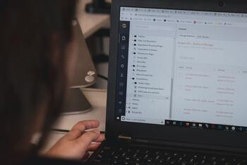 Business professional analyzing laptop