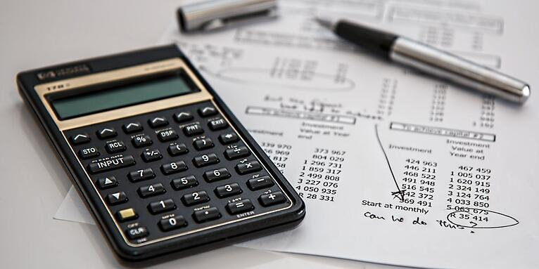 Business Owner Preparing Financial Sheets