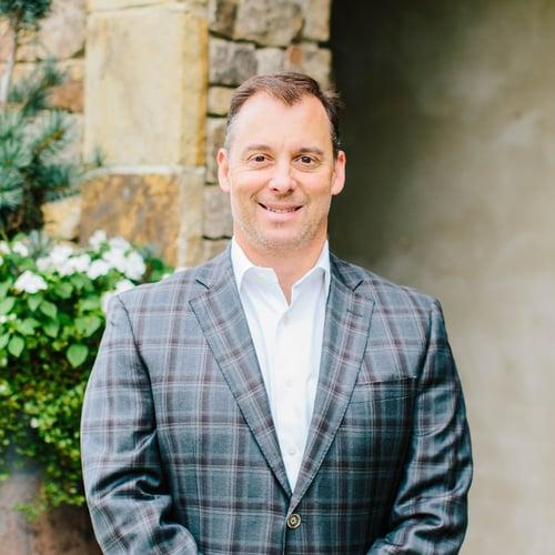 Headshot of Charlie Watkins, VP, Finance at OneAscent