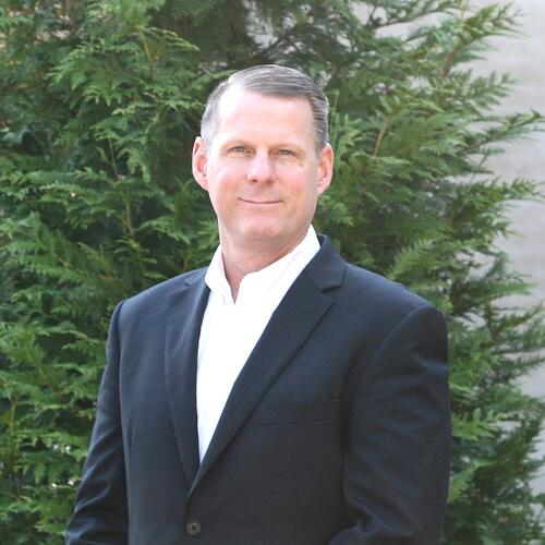Headshot of John Siverling, Director of Private Markets and Impact Advocacy at OneAscent