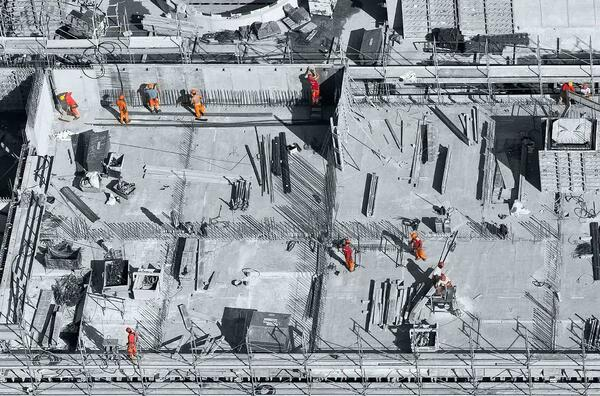 Construction workers on a building site, representing a business building a virtual desktop infrastructure.
