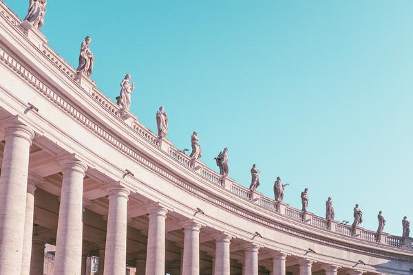 10 myths why you can't move to WVD this year - image of statues on a building and a blue sky