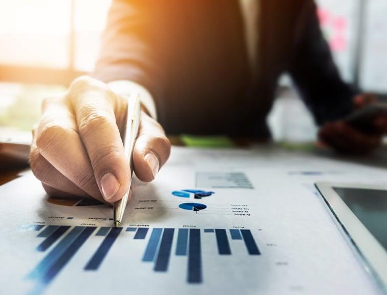 Investor-reading-financial-charts