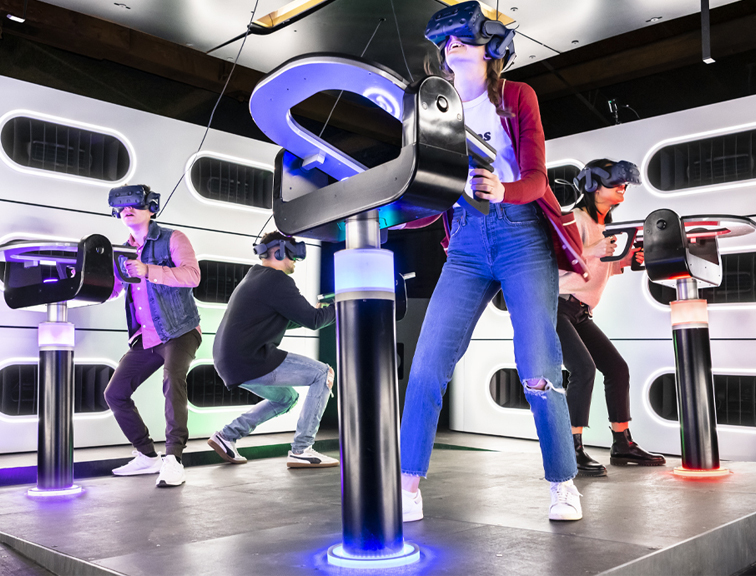 Four people enjoy a VR immersive haptic experience