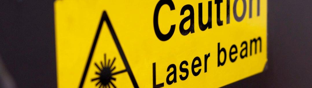Laser Beam Caution Yellow Sign