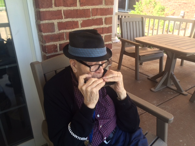 Resident Playing Harmonica