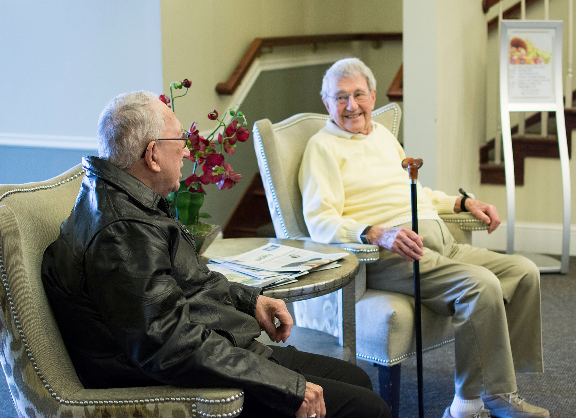 Care Suites Men Talking
