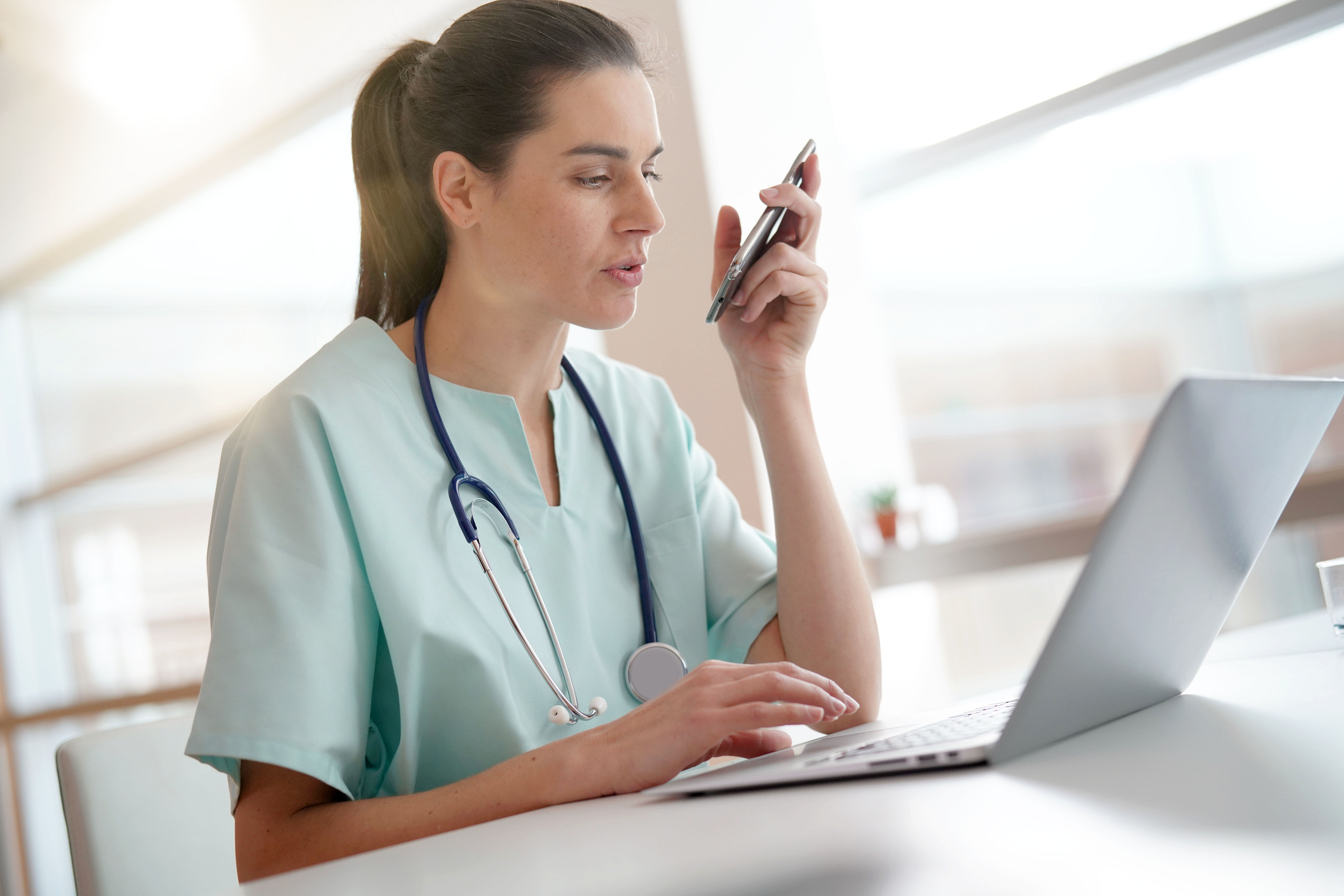 female-doctor-at-desk-with-laptop